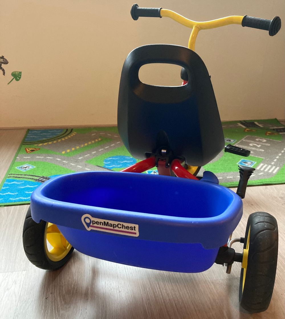 tricycle with OpenMapChest logo